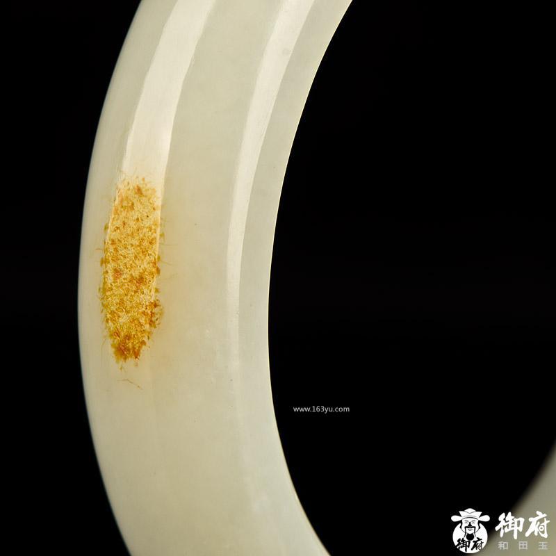 玉手镯上雕刻花纹的是什么年代